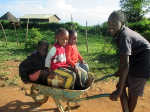 children-playing-in-wheelbarrow-morsel-of-faith-ministries
