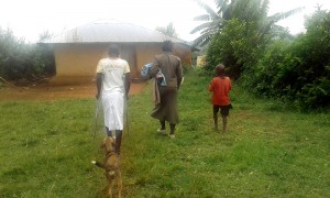 using-crutches-in-village-morsel-of-faith-ministries